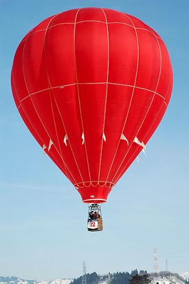 A hot air balloon (aircraft) in flight.