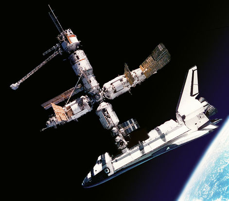 View of the Space Shuttle Atlantis docked to Russia's Mir Space Station, was photographed by the Mir-19 crew on July 4, 1995