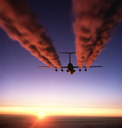 A C-141 Starlifter leaves exhaust contrails over Antarctica