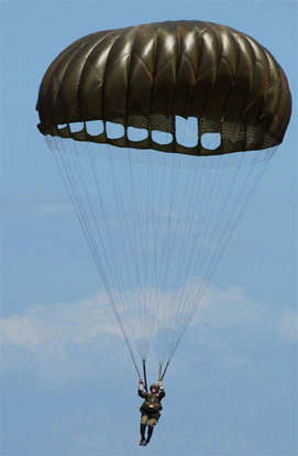 An American paratrooper using an MC1-1C series 'round' parachute