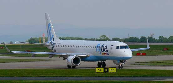 Embraer 195 taxis at Manchester International Airport. UK