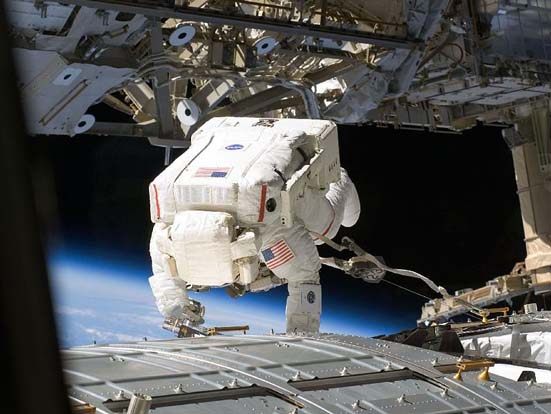 Mike Fossum works on the Kibo Module (JPM) during the second spacewalk of STS-124.