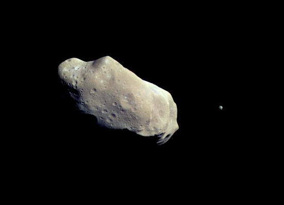 NASA image of 243 Ida. The tiny dot to the right is its moon, Dactyl.