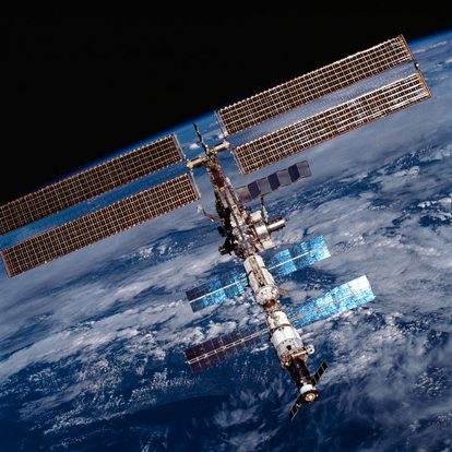 The ISS in 2001, showing the solar panels on Zarya and Zvezda, in addition to the US P6 solar arrays.
