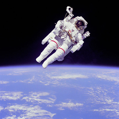 Astronaut Bruce McCandless II using a Manned Maneuvering Unit outside the United States Space Shuttle Challenger in 1984.