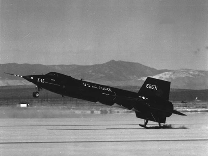 X-15 touching down on its skids. Compare jettisoned lower ventral fin with color picture, top.