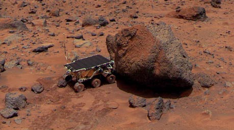 The Sojourner Rover is taking its Alpha Proton X-ray Spectrometer measurement of the Yogi Rock (NASA)