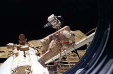 View of Mir-24 commander Anatoly Solovyev performing an EVA.