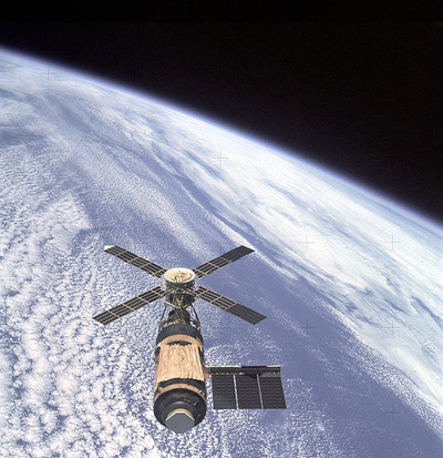 View of Skylab space station cluster in Earth orbit from the departing Skylab 4 command module.