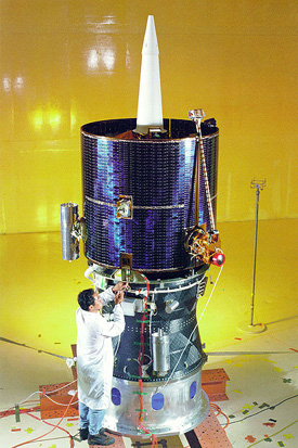 The fully assembled Lunar Prospector spacecraft is shown mated atop the Star 37 Trans Lunar Injection module