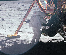 Neil Armstrong works at the LM in one of the few photos taken of him from the lunar surface. NASA photo as 11-40-5886.