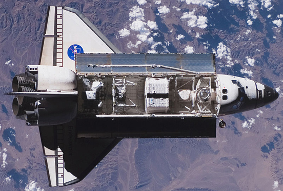 The Space Shuttle Endeavour approaching the ISS during STS-118.