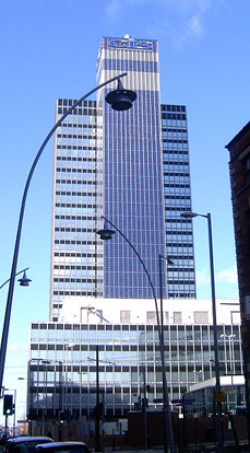 The CIS Tower, Manchester, England, was clad in PV panels at a cost of £5.5 million. It started feeding electricity to the national grid in November 2005.
