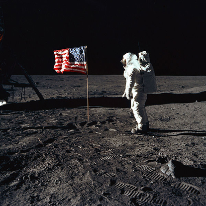 This image shows Apollo 11 astronaut Buzz Aldrin with the U.S. flag. The illusion of a breeze was caused by the horizontal rod intended to hold the flag flat failing to telescope out completely, thus leaving ripples in the fabric like those seen in a flag in the wind.