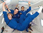 Mission Specialist Educators Lindenberger, Arnold, and Acaba during a parabolic flight.