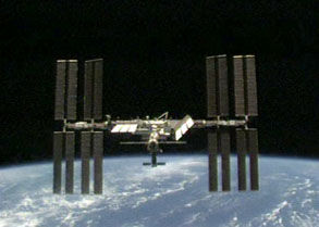 The International Space Station in earth orbit after a visit from the crew of STS-119