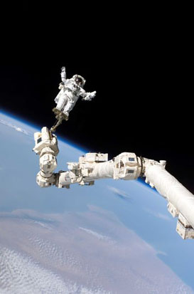 Stephen Robinson riding the robotic arm during STS-114.
