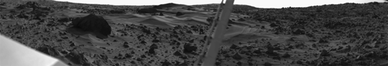 Dust dunes and a large boulder taken by the Viking 1 lander.
