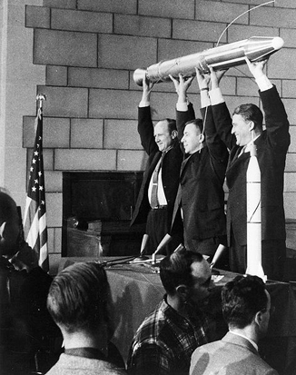William H. Pickering, James A. Van Allen, and Wernher von Braun displaying a full-scale model of the Explorer 1 satellite at a crowded press conference held in the Great Hall of the National Academy of Sciences at 1:30 A.M. when it was confirmed that the satellite was in orbit around the Earth.