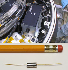 Closeup of the type of accelerometer that was installed backwards, alongside a pencil for scale (lower section) with a view of the spacecraft capsule and bus.